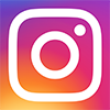 White Instagram logo on multi-colored background